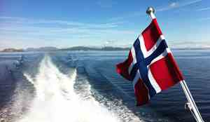 Norwegian flag on the back of a boat